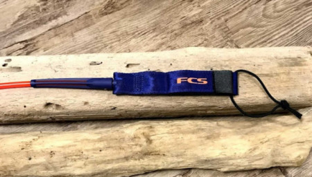 FCS two way rail saver on the regular surf leash