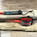 FCS surf leash in charcoal and blood orange
