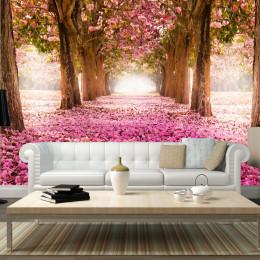 Fototapet vlies Bolta florala roz printre copaci