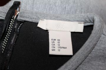 Bluză model peplum gri