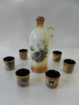 Set ceramic din 6 pahare de 0.04 l ptr. tuica si sticluta ceramic. 0.7 L