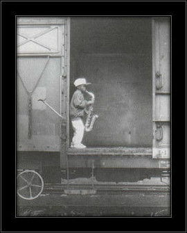 Slika Mali saksofonista u vozu, uramljena slika