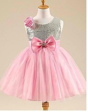 Shimmering silver dress with pink tulle and bow