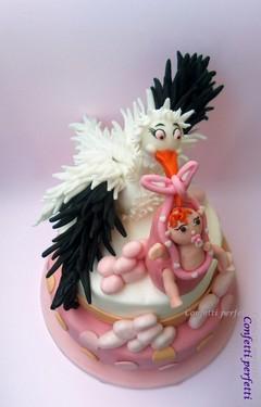 Torta decorata in pasta di zucchero Cicogna con bambina.