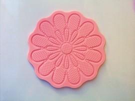 Stampo in silicone per creare un grande fiore decorato.