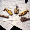 Musica. Set di 12 Tagliapasta in metallo a forma di Strumenti Musicali.