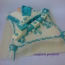 Torta decorata in pasta di zucchero Bebè Cuscini e trenino.