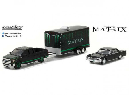 GREENLIGHT 1:64 - FORD F150 2015 WITH 1965 LINCOLN CONTINENTAL IN ENCLOSED CAR HAULER *THE MATRIX*, HOLLYWOOD HITCH