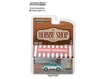GREENLIGHT 1:64 - VOLKSWAGEN CLASSIC BEETLE WITH ROOF RACK AND WOMAN IN DRESS 'THE HOBBY SHOP SERIES 1'