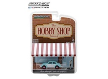 GREENLIGHT 1:64 - CLASSIC VOLKSWAGEN BEETLE WITH BACKPACKER FIGURE 'THE HOBBY SHOP SERIES 4'