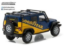 GREENLIGHT 1:43 - JEEP WRANGLER 2016 UNLIMITED *GOODYEAR* WITH ROOF RACK, FENDER FLARES AND WINCH, YELLOW/BLUE