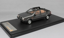 PREMIUM X 1:43 - LANCIA DELTA SELENE SEMI- CONVERTIBLE 1983 DARK GREY - RESIN, GRAY