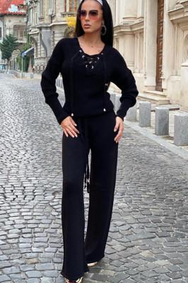 Compleu negru dama tricotat cu bluza petrecuta si pantalon evazat