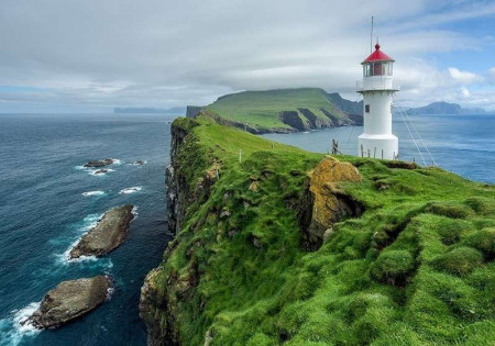 Lighthouse on a small green island wallpaper - 13020