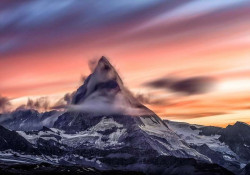 White mountain peak in a misty red sky wall mural - 12990