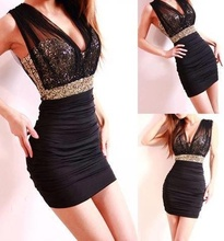 Crna neobicna haljina sa zlatnim diskicima
