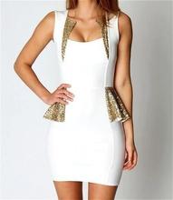 Bela haljina sa zlatnim diskicima