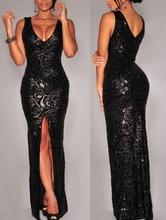 Duga crna haljina sa neobicnim radom diskica