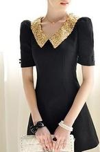 Crna haljina sa zlatnom kragnom