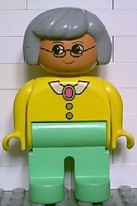 4555pb084 Duplo Figure, Female, Medium Green Legs, Yellow Blouse with Collar, Gray Hair, Glasses *