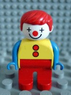 4555pb002 Duplo Figure, Male Clown, Red Legs, Yellow Top with 2 Buttons, Blue Arms, Red Hair Straight loc