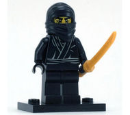 col01-12 Ninja, zwart met parelgoud ninja zwaard en standaard NIEUW loc