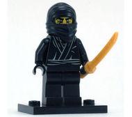 col01-12 Ninja, zwart met parelgoud ninja zwaard en standaard NIEUW *0M0000