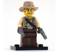 col01-16 Cowboy met pitool en voetsuk NIEUW loc