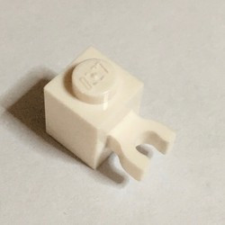 White Brick, Modified 1 x 1 with Open U Clip (Vertical Grip) - used - Solid Stud