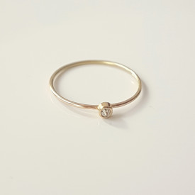 minimalist 18k gold ring with tiny white diamond