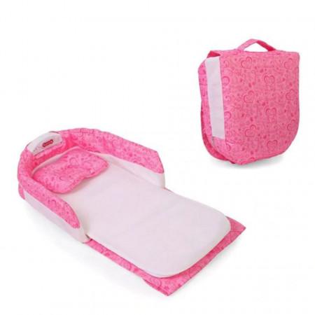 Pătuț portabil de culoare roz pentru bebeluși, tip geantă