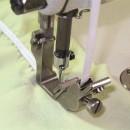Dispozitiv aplicat-incretit /banda-elastic