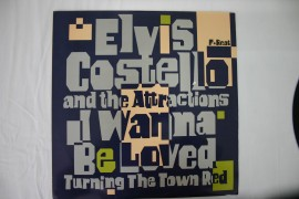 Elvis Costello And The Attractions ‎– сингъл I Wanna Be Loved / Turning The Town Red изображения