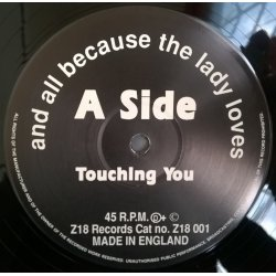 And All Because The Lady Loves... – сингъл Touching You