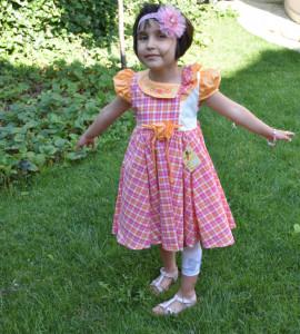 Rochiță în carouri roz și portocalii