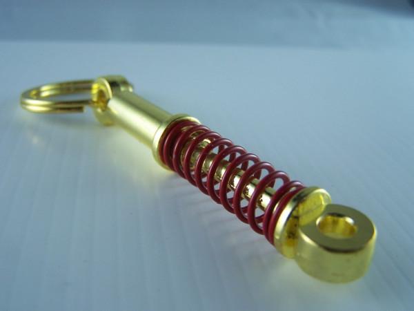 Porta Chaves - Amortecedor Dourado/Vermelho