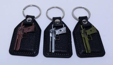 Fita porta chaves com pistola