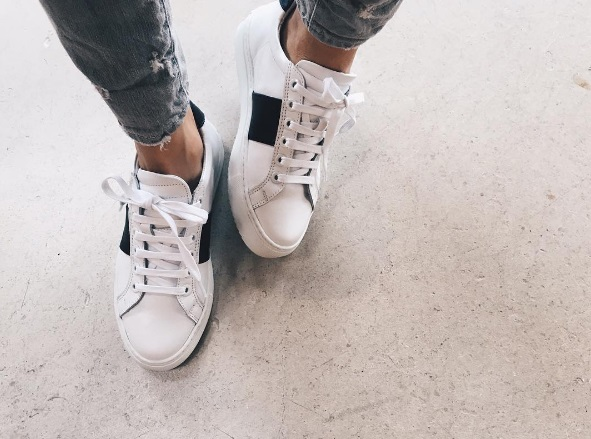 Sneakers bianca national standard con banda nera