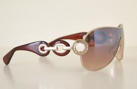 Occhiali da sole donna marrone con cerchi in metallo argento
