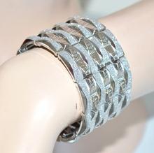 Bracciale donna argento in metallo a molla semi-rigido con brillantini 95