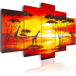 Tablou - Giraffes on the background with sunset