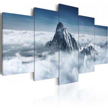 Tablou - A peak rising above the clouds