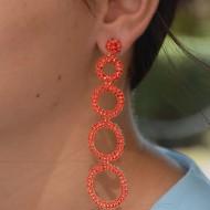 Cercei deosebiti cu forma alungita, accesorizati cu perle si strasuri