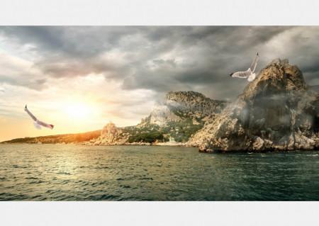 Fototapete Un apus de soare asfinit peste dealuri.