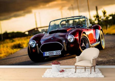 Fototapet, Vehicul retro roșu la apus de soare