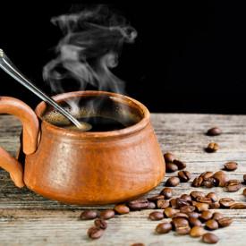 Multicanvas, O ceașcă cafenie cu cafea.