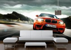 Fototapet Transport, O mașină portocalie pe fundalul de norilor