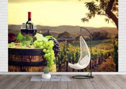 Fototapet, Sticla de vin pe fundalul unui câmp de vie