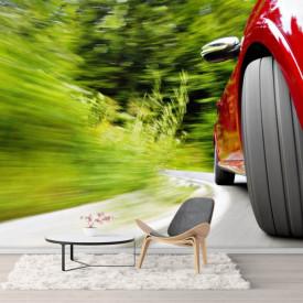 Fototapete, Fotografia unei mașini roșii în mișcare.
