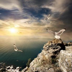 Fototapet, Un apus de soare frumos peste dealuri